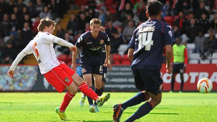 Luke Freeman fires Stevenage in front after a defensive error gifts him the ball. Photo: Danny Loo