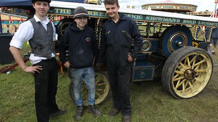 Jack Hollingsworth, Louis Bradshaw and Alexander Haslett-Saunders stand next to a mini mayor engine