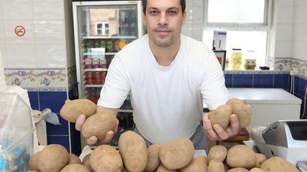 Dragan Marjanovic with his potatoes in his fish and chip shop in Arlesey