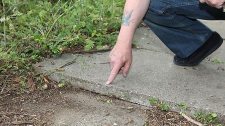 Wonky paving stones along a footpath on Grace Way are causing concern for local residents