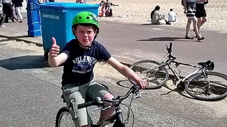 Freddie on his bike after finishing his 14-mile ride for charity