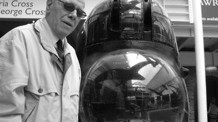 War veteran Fred Arnold pictured with a Lancaster Bomber at the Imperial War Museum