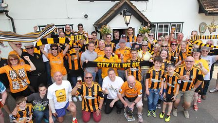 Hull City fans outside the 'Black and Amber Tree' in Baldock