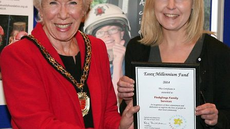 Cllr Kay Twitchen, chairman of Essex County Council, presents the award to Emma Holbrook, fundraisin