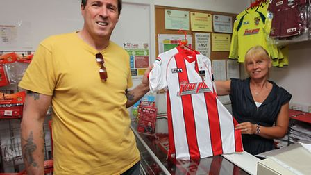 Stevenage fan Kevin Rayment is the first to get his hands on the new home kit for the 2014/2015 seas