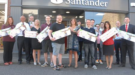 Saffron Walden Town Team members with copies of the Tour de France leaflet which is aimed at promoti