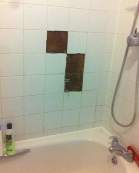 Tiles have fallen off the bathroom because of the damp