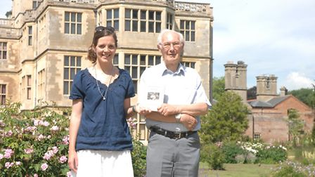 Jilly and Hugh, holding a copy of the book, at Audley End House.