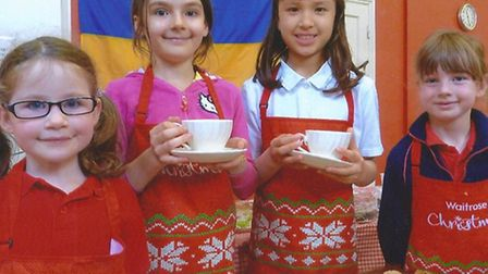 1st Saffron Walden Girls' Brigade's Patricia, Keira, Abigail and Emily serve up drinks and cakes at
