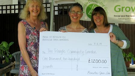 From left to right: Tish Cook, organiser of Benslow Open Gardens presents cheque to Vicky Wyer, chai
