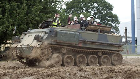 Taking a thrilling ride in an armoured personnel carrier.