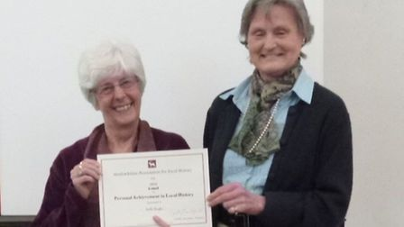 Photo of Scilla Douglas receiving her award from president of The Hertfordshire Association for Loca