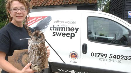 Uttlesford chimney sweep Jessica Hayes with the stuffed tawny owl.