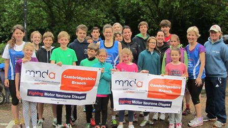 Members of the YacYak Running Club stopped their training in the rain to help Clare Thompson and Ste