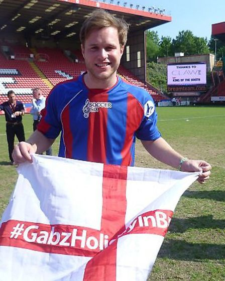 Popstar Olly Murs pictured witha Gabz flag