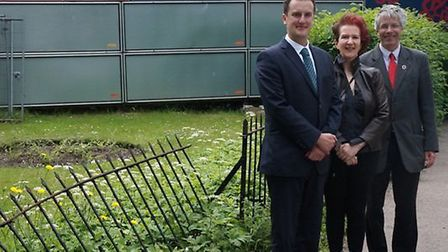 Headteacher Mark Lewis with councillors Amanda King and Jim Brown, pictured next to a damaged fence,