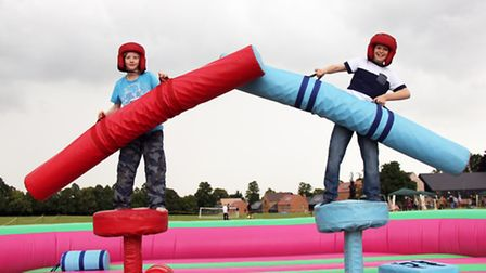 Reuben Storey and Jack Tayor try out jousting.