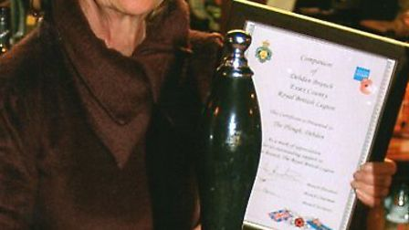 Margaret Holland with her certificate.