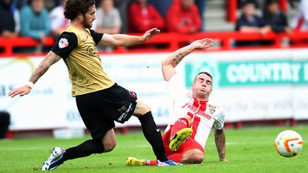 James Dunne, here putting in a tackle, is a target for Portsmouth
