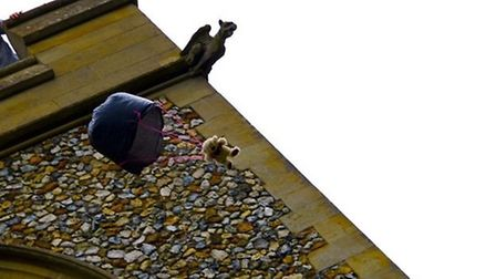 One of the teddy bears takes a skydive from the church tower in Farnham.