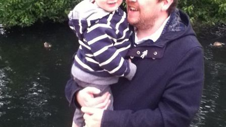 Comet sports editor Damion Roberts with his son Barney, who was born following IVF treatment