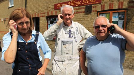 Nicola Clark, Edward Picken and Colin Trevillion, Pirton residents with their mobile phones