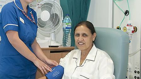 Jasvir Mangat, pictured with nurse Natasha Davies, was the first patient to be treated in the new wa