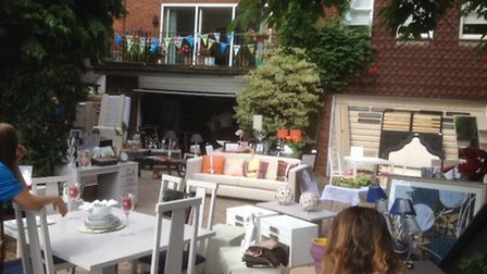 A garage sale held in aid of the Sue Ryder charity raised more than £4,000