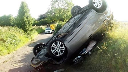 The car overturned in Swangleys Lane near Datchworth. Picture by @AmboOfficer via Twitter.