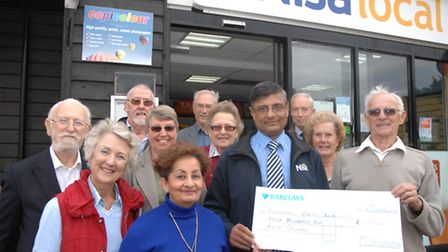 A tight-knit community: Members of Clavering Bowls Club receiving a cheque from the village's Nisa L