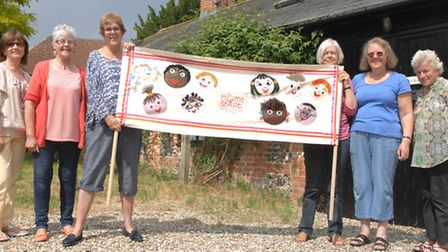 Keen knitters from Saffron Walden created the eye-catching display for Homestart's 30th anniversary.