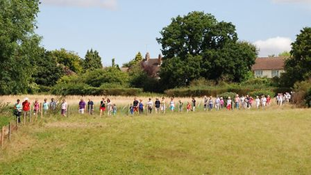 Members of the public turned out to take part in a guided walk through an area of green belt propose