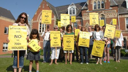 Residents protest outside Uttlesford District Council's offices in opposition to 600-700 home scheme