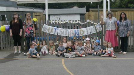 Staff and children from Abington Pre-School celebrating their Outstanding result.