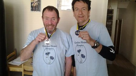 Des and Steve with their medals from the London Nightrider 2014 challenge