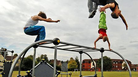 Three young people take part in a parkour demonstration