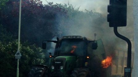Danny Bunyan took this picture just as the tractor caught fire as he waited at the traffic lights in