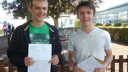 Students Tom Walker and Tobi Cahill eith their GCSE results at The John Henry Newman School