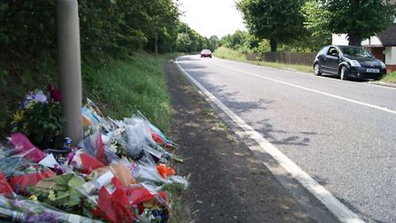 Flowers on the road where Jack Alexander, 20, died on Thursday, July 17