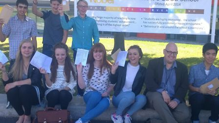 Nobel students with their results. Back row: Bobby Banks, Lewis Day and Benjamin Gray. Front, left t