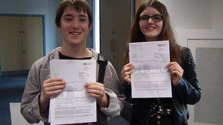 North Herts College students James Norman and Pebbles Buckley receiving their results.