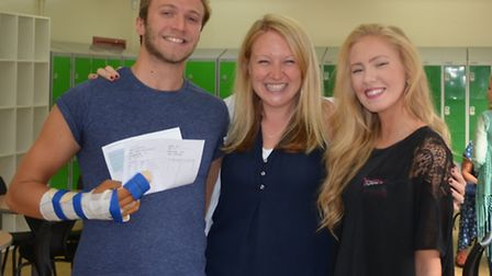 Students Matt Kerr and Laura Campbell with Mrs Edwards (centre), deputy director of John Henry Newma