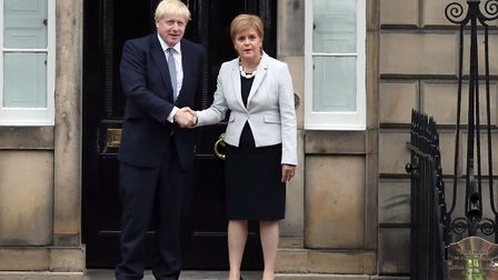 Scotland's First Minister Nicola Sturgeon welcomes Boris Johnson outside Bute House in Edinburgh ahe