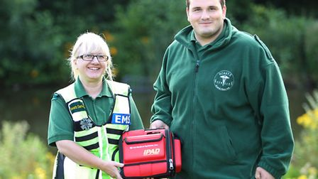 Hearts Services duo Sharon Hearn and Max Marchant with the defibrillator they used to save a man's l
