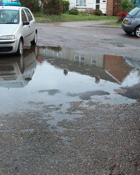 The road outside Mr Sewell's house has been regularly flooding for more than 30 years