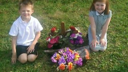Christopher Bysouth, 6, and Natasha Bysouth, 7, pictured with the memorial before it was stolen.