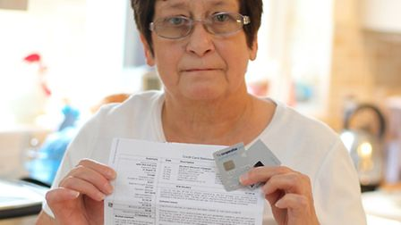 Marion Lovell pictured with her bank statement and old credit card, had her credit card details stol