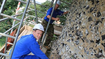 Foreman Ian Williams and Ross Jee, from Bakers of Danbury, get to work on the castle.