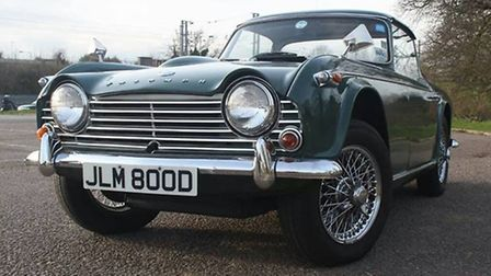 The green classic TR4a was stolen from the show