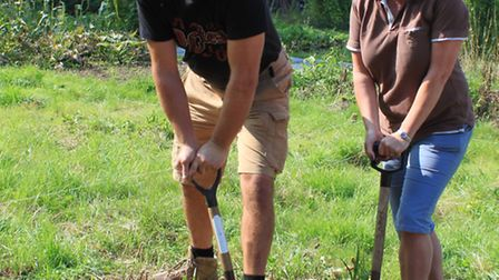Paul and Emma Wrigley get to work on their new allotment plot.